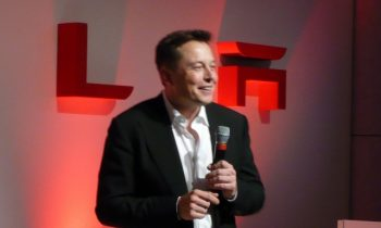 """Elon Musk is """"full of crap"""" with self-driving car promises, says GM exec"""