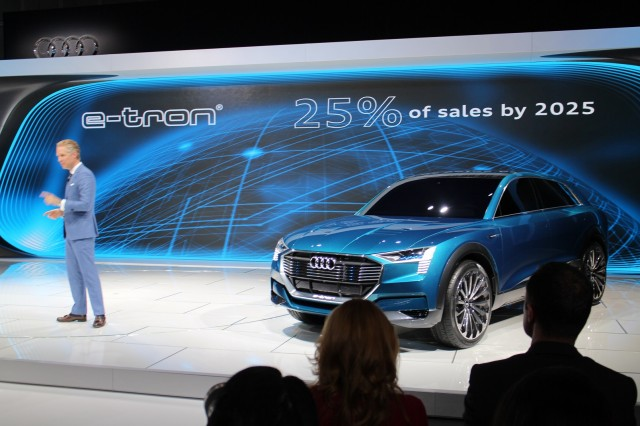 Audi of America president Scot Keogh with Audi e-tron quattro concept, 2015 Los Angeles auto show
